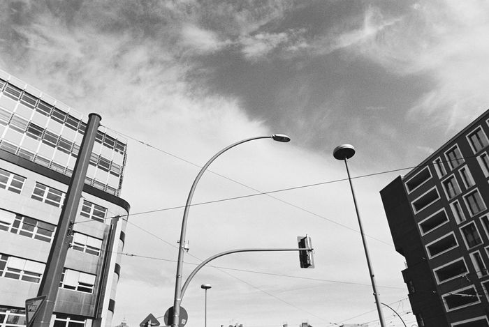 35mm Film Analogue Photography Black & White Buy Film Not Megapixels Nikon FA Streetlamp Architecture Blackandwhite Blue Sky Building Exterior City Day Film Photography Low Angle View Monochrome No People Outdoors Schwarzweiß Sky Street Light Berliner Ansichten Cityscape
