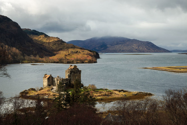 Mountain Sky Water Cloud - Sky Scenics - Nature Nature Beauty In Nature Architecture No People Day Sea Tranquil Scene Built Structure History Land Outdoors Tranquility Building Eilean Donan Castle british culture Scotland EyeEm Best Shots EyeEm Nature Lover Travel Destinations