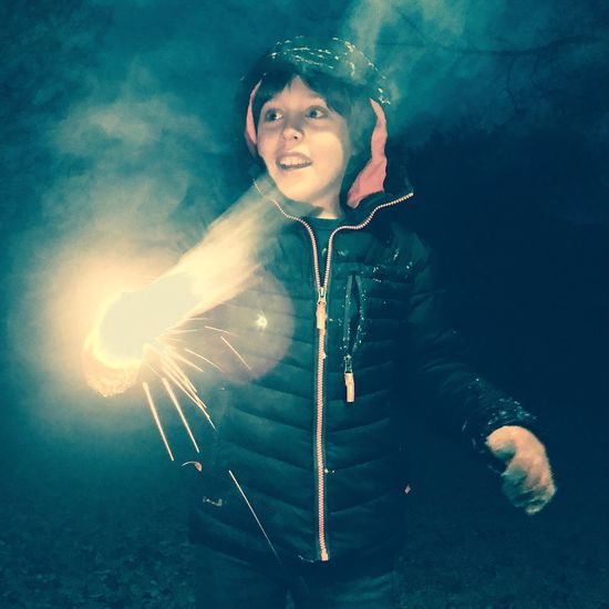 Happy Fun Celebrate Celebration Play Adventure Bright Light Sparkler Child Boy Winter Cold One Person Portrait Real People Music Childhood Leisure Activity Night Outdoors