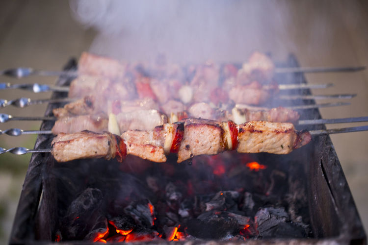 Close-Up Of Meat Grilling On Barbecue