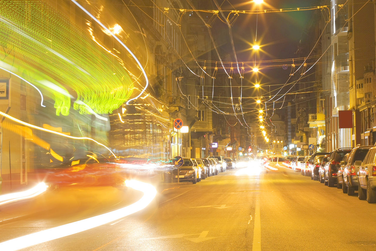 illuminated, night, long exposure, light trail, transportation, speed, motion, blurred motion, road, street, land vehicle, car, built structure, high street, outdoors, street light, architecture, building exterior, no people, city