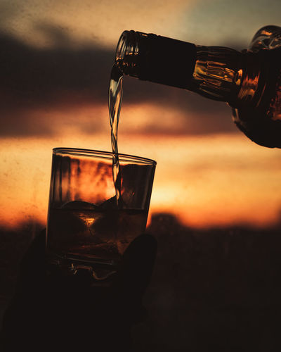Liquid Gold EyeEm Best Shots EyeEmNewHere EyeEm Nature Lover EyeEm Selects EyeEm Gallery Nikon D750 Concept Conceptual Focus On Background Sharp Dark Photography Moon Surface Tripod Toronto Ontario Canada Canadian Best  Fresh New Drink Refreshment Glass Food And Drink Alcohol Pouring Drinking Glass Household Equipment Bottle Sunset Focus On Foreground Glass - Material Close-up Freshness Motion Transparent Container Nature Sky Drinking Single Malt Refined Whisky Bourbon Silhouette