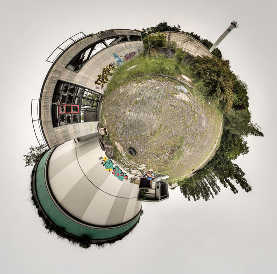 Digital composite image of building and trees against sky