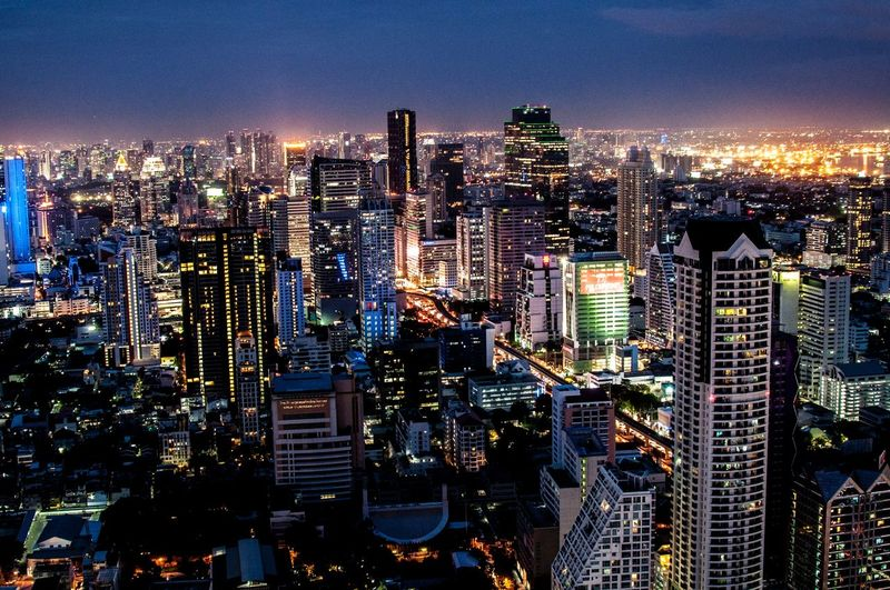 High angle view of illuminated cityscape against sky