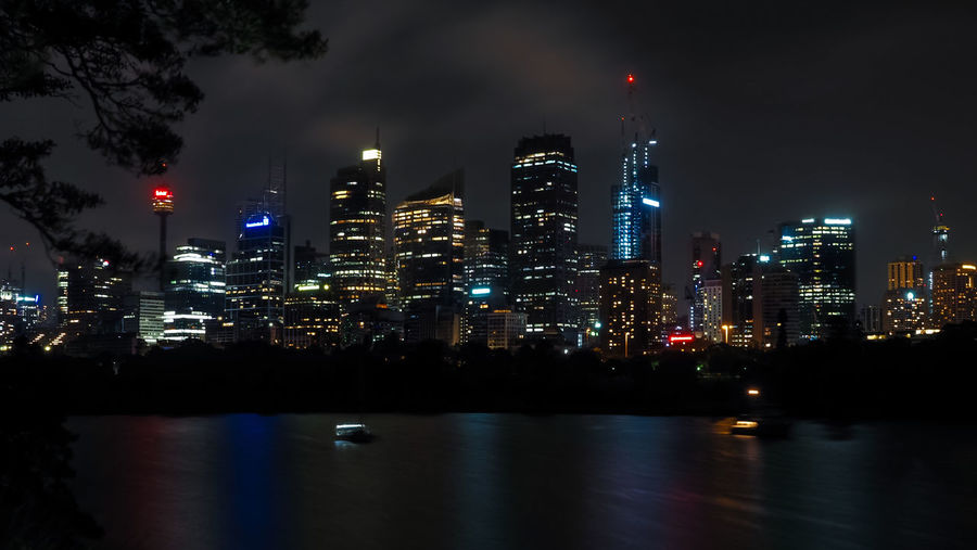 Beautiful sydney harbor with office buildings light and illumination at night.