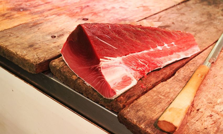 Close-up of raw meat on cutting board