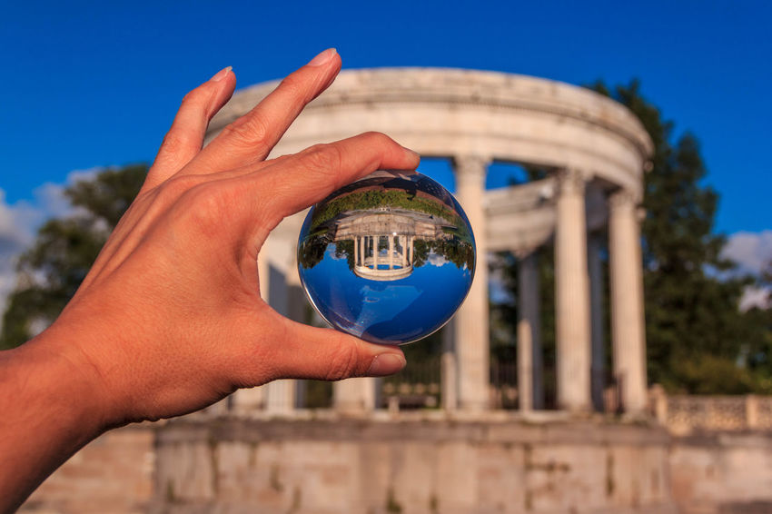 A view from a glass ball. Coliseum Crystal Ball Crystal Ball Photography Glass Ball Human Finger New York City Perspective Photography See Through Sky Sky And Clouds Sphere Untermyer Park Untermyer Park And Garden Yonkers