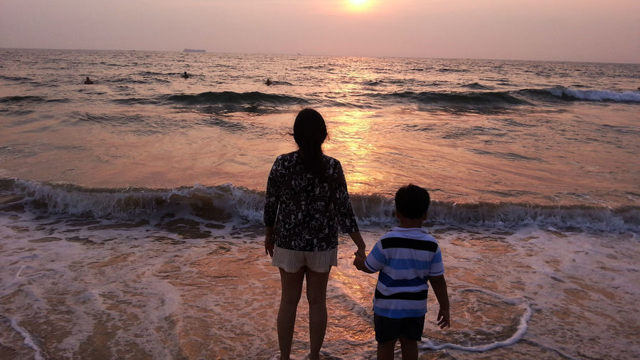 Sunset in Goa Ankle Deep In Water Beach Bonding EyeEmNewHere Horizon Over Water Leisure Activity Lifestyles Love Nature Outdoors Rakeshtiwari Real People Scenics Sea Sky Standing Sunset Togetherness Two People Vacations Water Wave Women