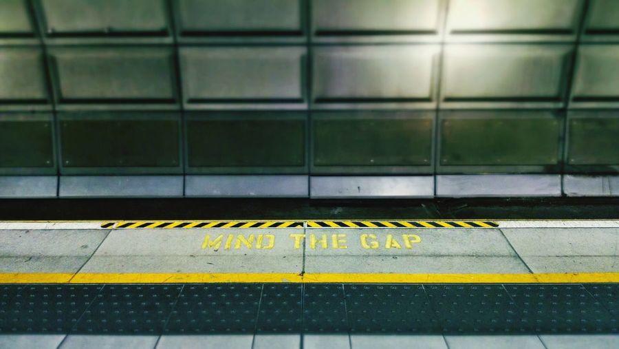 Mind gap sign on subway platform