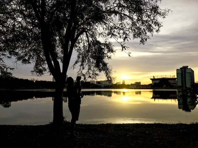 Father and son watching the sunset. City River Building Exterior Shadow Backgrounds Father Parent Son Water Sky Reflection Tree Lake Nature Silhouette Cloud - Sky Reflection Lake Plant Built Structure Building Exterior Scenics - Nature Beauty In Nature Sunset Architecture Waterfront Tranquility Outdoors EyeEmNewHere Autumn Mood