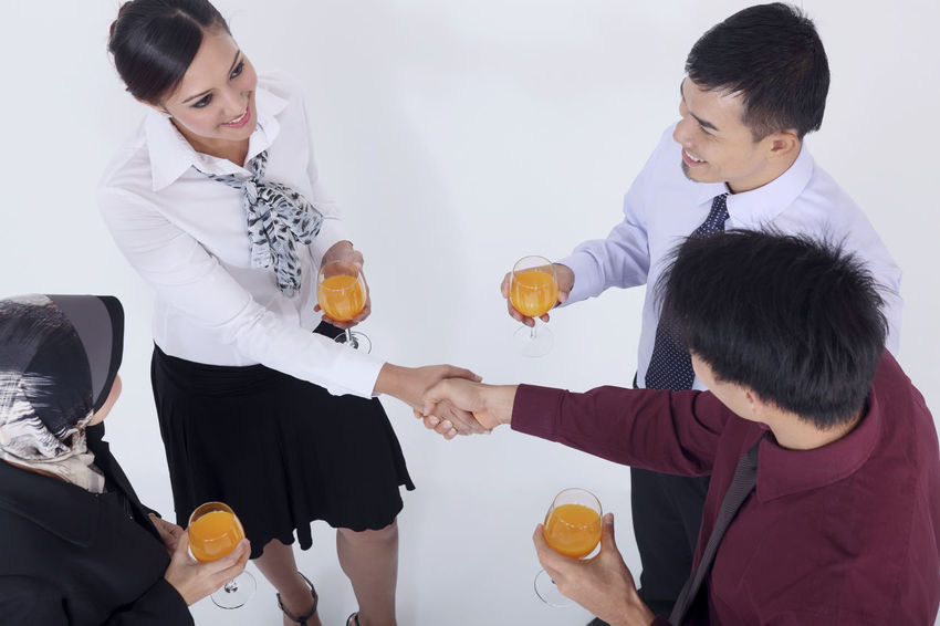 high angle view of group of people in business wear discussion Business Discussion Indian Teamwork Business Person Chinese Friendship Glass Of Orange Juice Group Of People Hand Shake Harmony High Angle View Hijab Holding Malay Malaysian Mixed Race Multiracial  Portrait Studio Shot Talking Togetherness Tudung United Young Adult