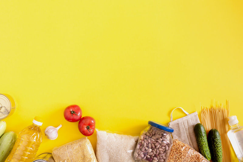 Close-up of fruits on table against yellow background