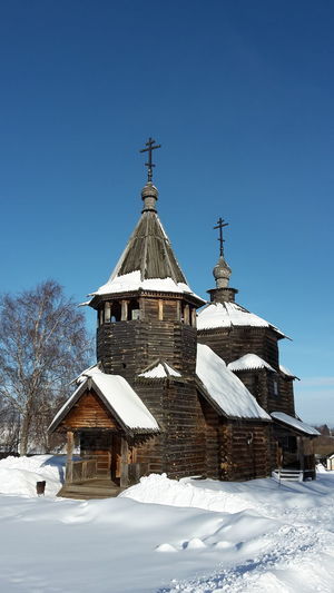 Old wooden church in the open air museum of Suzdal', Russia Snow Winter Cold Temperature Architecture Built Structure Sky Building Exterior Clear Sky Building Nature Religion Day Covering Blue No People Belief Place Of Worship Spirituality Outdoors Open Air Museum Church Wooden Church  Landmark Historical Cultural