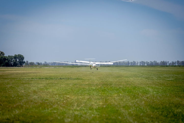 Taking off Air Vehicle Airplane Grass Sky Mode Of Transportation Airport Transportation Nature Copy Space Day No People Land Airport Runway Outdoors Flying Field Aerospace Industry Córdoba Argentina Take Off Gliding Soaring Segelflugzeug Segelflug Towplane