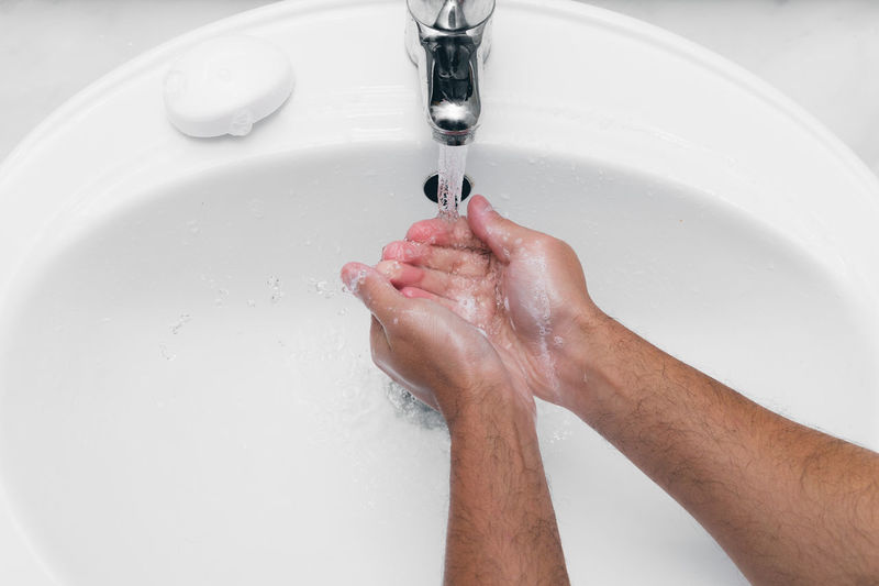 Adult caucasian male washing hands with soap under the faucet with water Human Body Part Human Hand Hygiene Water Hands Faucet Washing Washing Hands High Angle View Indoors  Home Bacteria Bathroom Body Care Bubbles Care Caucasian Man Male Cleaning Close-up Consumption  Disinfection Flu Healthy Lifestyle Healthy Healthcare And Medicine Infection Liquid Microbe Palm Skin Skin Care Soap Soap Bubbles Stream Washroom Waste Wet Running Water