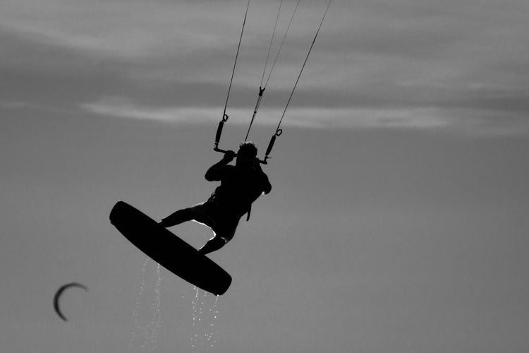 ..fly.. . Adventure Black And White Blackandwhite Day Exhilaration Extreme Sports Full Length Joy Kiteboarding Leisure Activity Lifestyles Men Mid-air Motion Nature One Person Outdoors Real People Sky Sport Vitality