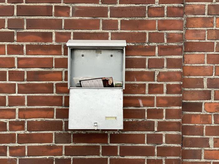 Close-up of mailbox on brick wall