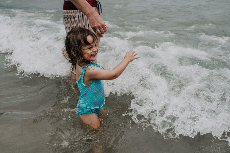 My daughter playing in the sea for the first time <3 Playing With The Animals Bathing Suit  Beach Childhood Elementary Age Father And Daughter Fun Girls Leisure Activity Lifestyles Nature Outdoors Parenting Playing Real People Sea Summer Toddler  Water