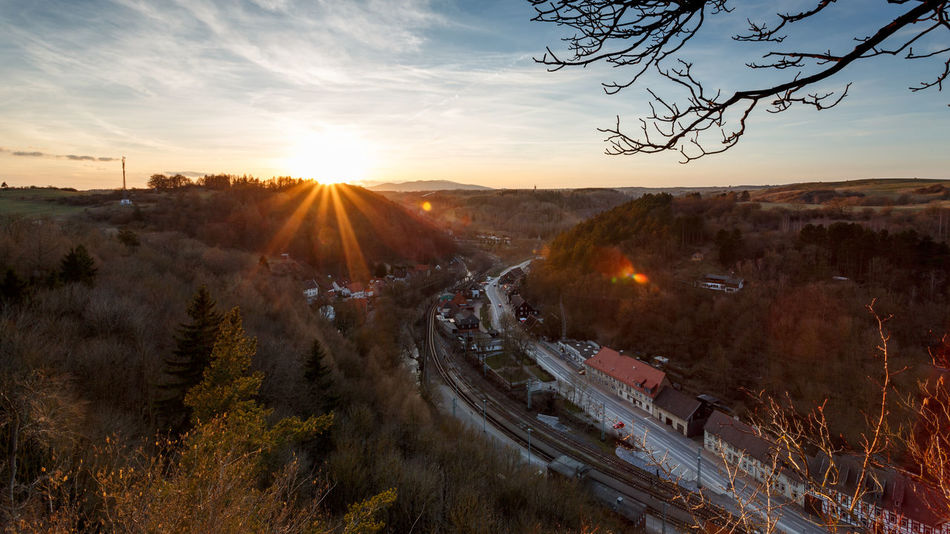 Sonnenuntergang über Rübeland im Harz Livefolk Beauty In Nature Built Structure Environment Germany Harz Harzmountains High Angle View Landscape Lens Flare Mountain Nature No People Orange Color Outdoors Plant Road Scenics - Nature Sky Sun Sunbeam Sunlight Sunset Transportation Tree