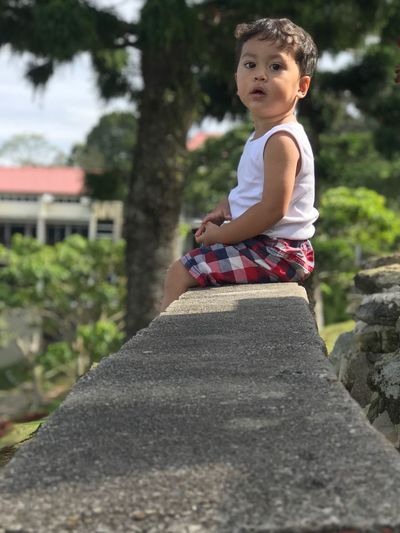 Kid Boy Aydin One Person Childhood Real People Full Length Casual Clothing Day Focus On Foreground Outdoors Leisure Activity Elementary Age Sitting Nature Standing Tree People Side View
