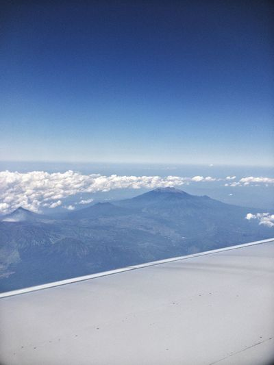 Shot from Singapore Airlines to Bali Cloud Mountain Bali Airplane Water Beauty In Nature Land Day Blue Sky Scenics - Nature Nature