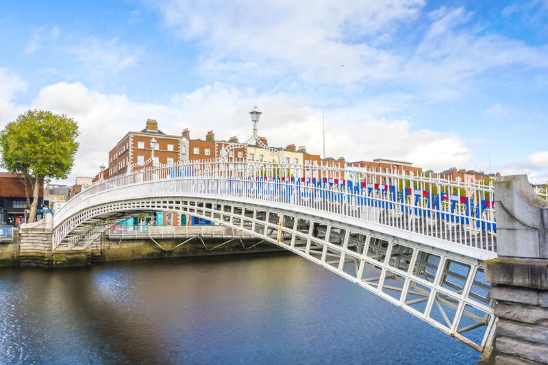 View of Hapenny Bridge over Liffey river in Dublin, Ireland Architecture Built Structure Bridge Bridge - Man Made Structure Water River City Waterfront Nature Travel Destinations Arch Bridge Dublin Ireland Irish Europe Capital Cities  Famous Place Hapennybridge Destination Travel Tourism Tourism Destination Footbridge Half Penny Liffey Liffeyriver