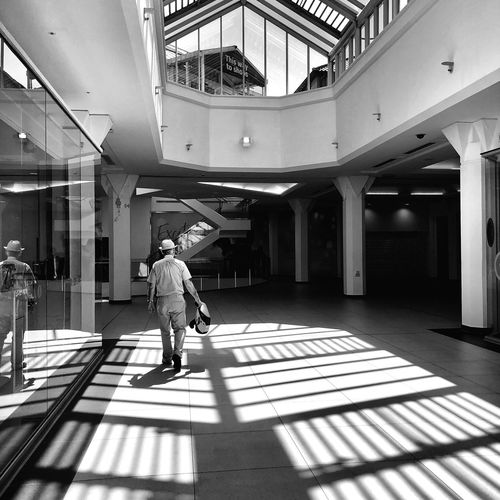 Geometry and light➡️Geolight EyeEm Gallery Eye4photography  EyeEmNewHere EyeEm Best Shots Pattern IPhoneX Iphonesia ShotOnIphone Blackandwhite Geolight Geometry Shadow Light Light And Shadow Blackandwhite Monochrome Streetphotography Man Full Length Real People One Person Built Structure Architecture Shadow Sunlight Day Casual Clothing Walking Males  Men