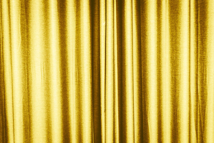 Full frame shot of gold colored curtain