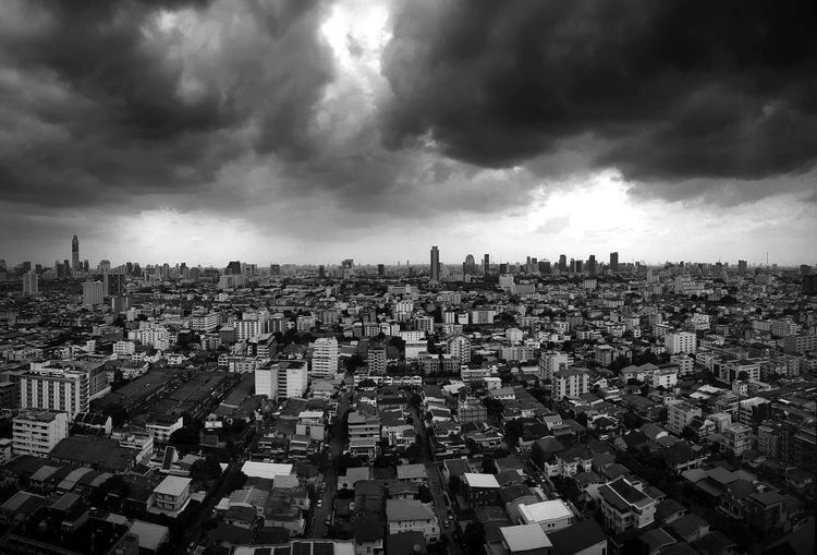 Bangkok cityscape in black and white. Bangkok view from window. Cityscape view from window. Cloudy sky above city. Cityscape Cloudy Architecture Black And White Building Building Exterior Built Structure City Cityscape Cloud - Sky Crowd Crowded Day Financial District  High Angle View Nature Office Building Exterior Ominous Outdoors Overcast Residential District Sky Skyscraper Storm Storm Cloud First Eyeem Photo