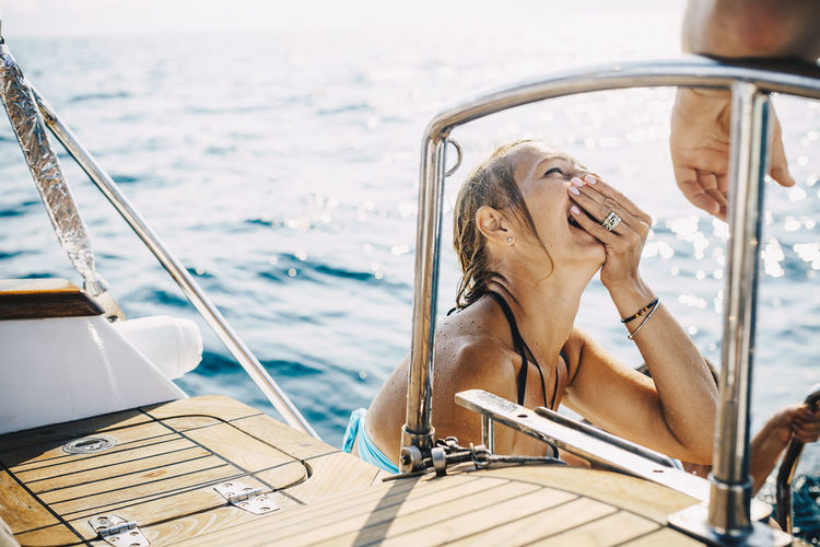 Woman on boat sailing in sea