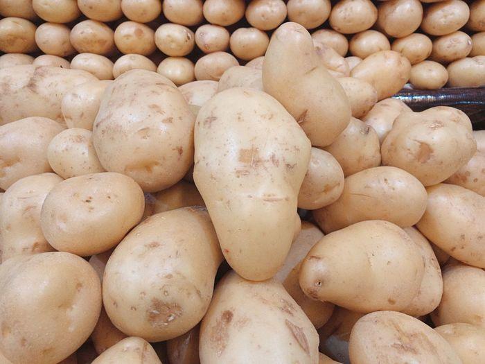 Full frame shot of potatoes for sale in market
