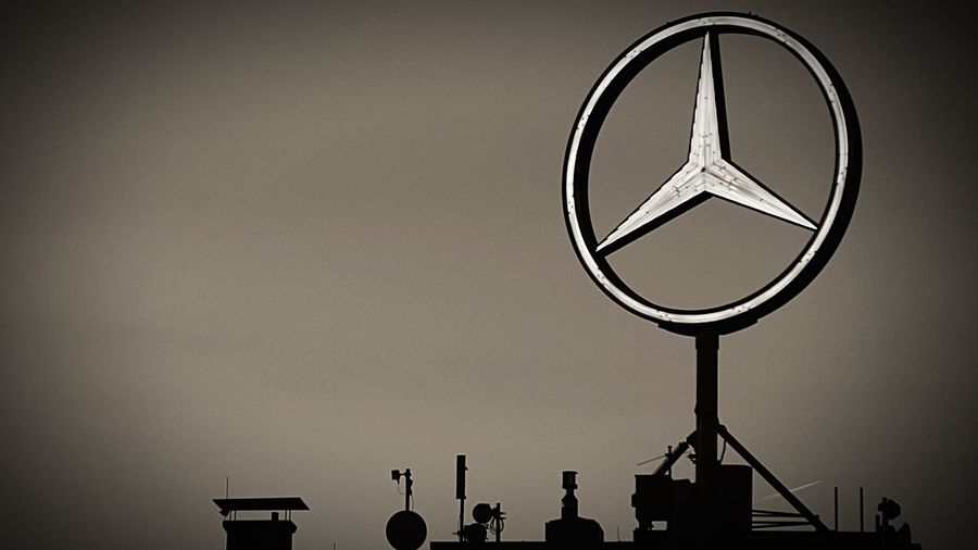 Taking Pictures Blackandwhite Photography Black & White Mercedes Star Mercedes-Benz Sky Silhouette Low Angle View Communication Architecture Outdoors No People Geometric Shape Sign Shape Clear Sky Day Built Structure
