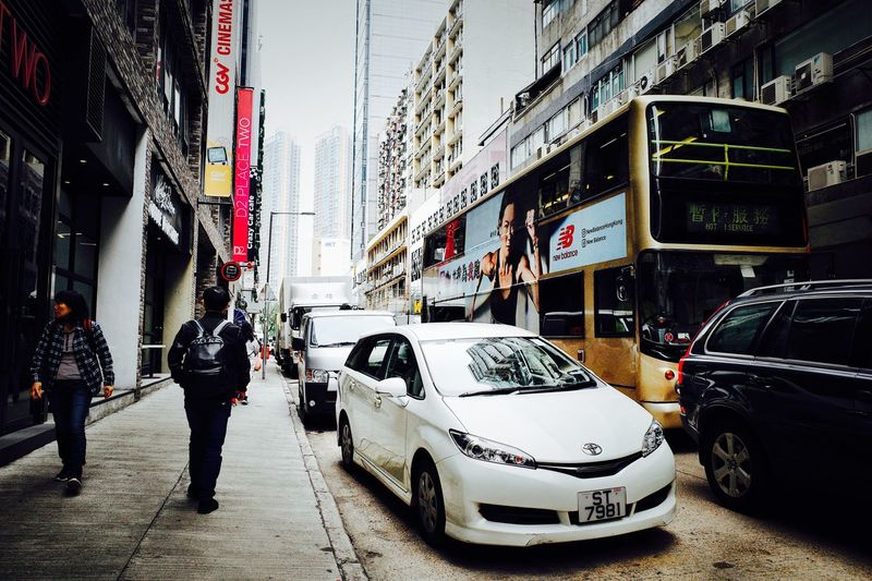 Ricoh Street Built Structure Land Vehicle Architecture Building Exterior City Life City Street People Mode Of Transportation Incidental People Motor Vehicle Transportation Adult Taxi Full Length Traffic Lifestyles Road City Car