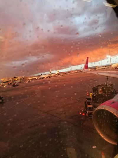 Travel Airplane Sunset Sky Water Airport Airport Runway Reflection Illuminated Dramatic Sky Cloud - Sky Raindrops Rainy Airport Waiting Wizzair Sofia Airport Barajas