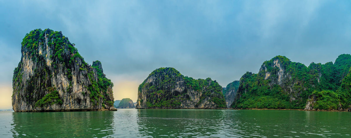 Beautiful view of Ha Long Bay, a very popular travel destination in Quang Ninh Province, northeast Vietnam Vietnam Cliff Ha Long Bay Ha Long Bay Cruise Limestone Sea Sunset Vientamese Landscape