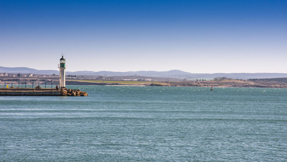 Arrival Beauty In Nature City Clear Sky Day Harbor Landscape Lighthouse Mountain Nautical Vessel No People Outdoors Port Sky Travel Travel Destinations Water