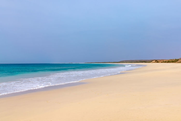 Santa Maria beach, Boa Vista, Cape Verde. The sandy beach is 18km with waves crashing from the Atlantic Ocean Boa Vista Cape Verde Cape Verde Beach Aquatic Sport Beach Beauty In Nature Blue Boa Vista Beach Boa Vista, Cabo Verde Horizon Horizon Over Water Land Motion Nature No People Outdoors Sand Santa Maria Beach Scenics - Nature Sea Sky Tranquil Scene Tranquility Water Wave