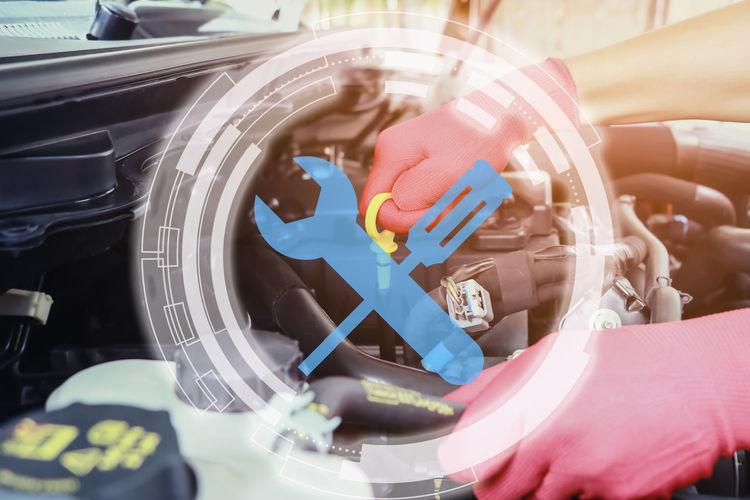 Digital composite image of mechanic repairing car