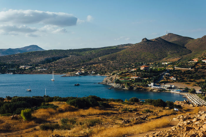 Cape Sounion Beauty In Nature Blue Boat Cape Sounion Cloud Coastline Great Outdoors With Adobe Hill Landscape Mountain Nature Nautical Vessel Outdoors Remote Sailing Scenics Sea Sounion Tranquil Scene Tranquility Travel Destinations Water