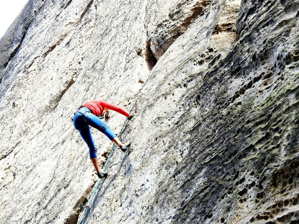 Adult Adventure Climbing Day Extreme Sports Flexibility Full Length Headwear Mountaineering Landscape One Person Outdoors People Rock - Object Rock Climbing Young Adult