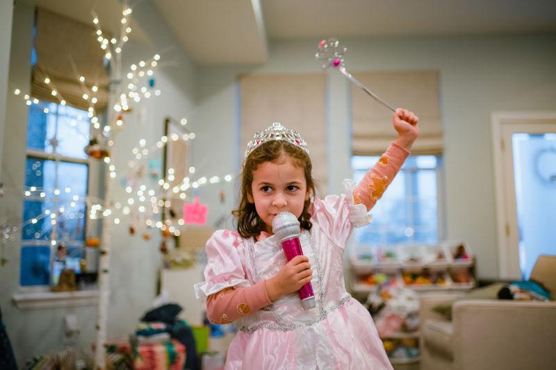 Portrait of happy girl holding indoors