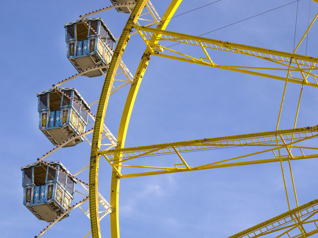Amusement Park Amusement Park Ride Architecture Arts Culture And Entertainment Blue Built Structure Clear Sky Day Fairground Ferris Wheel Fun Geometric Shape Low Angle View Metal Nature No People Outdoors Sky Tall - High Yellow