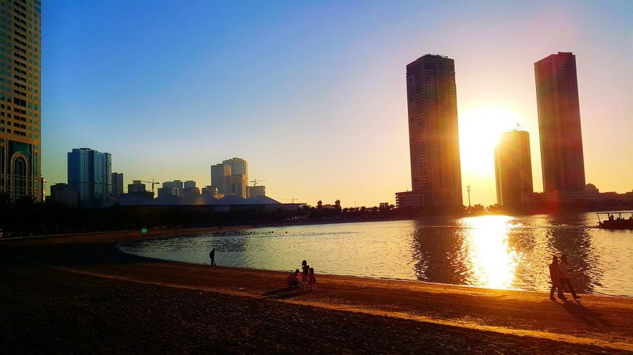 Beach First Eyeem Photo Outdoors Waterfront Modern Coastline City Life Vacations Shore Urban Skyline Sand Tall - High Tower Skyscraper Built Structure City Sky Sea Architecture Building Exterior Water