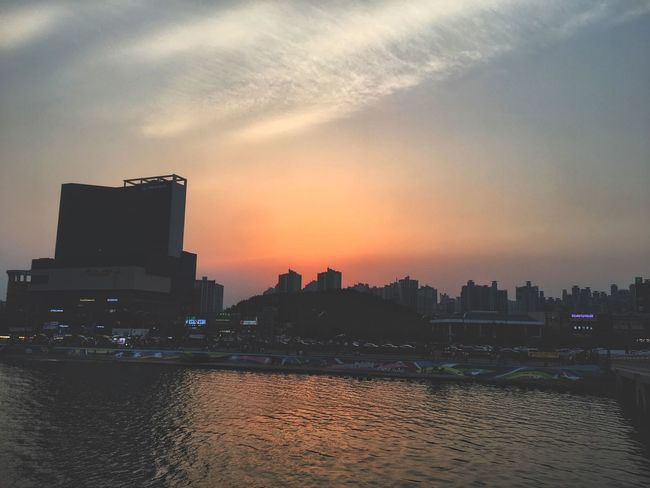 Sunset Architecture Built Structure Building Exterior Skyscraper City Development Sky Modern No People Cityscape Waterfront Travel Destinations Sea Urban Skyline Water Outdoors Nature Beauty In Nature Day