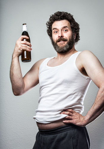 Funny Series of a Bearded Slob of a man, with beer belly and Bottle :) Beer Funny Humor Man Proud Proud Father Tanktop Adult Alcholic  Alcohol Beard Bearded Beer Belly Deplorable Holding One Person People Portrait Slob Tank Top