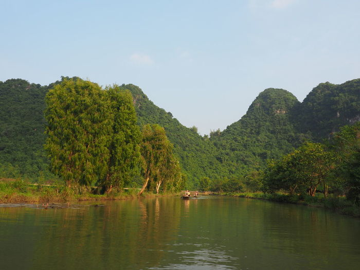 'The inland Ha Long Bay' Tam Coc Clear Sky Environment River EyeEm Nature Lover No People Non-urban Scene Reflection Nature Mountain Tranquility Scenics - Nature Tree Beauty In Nature Water Rowboats