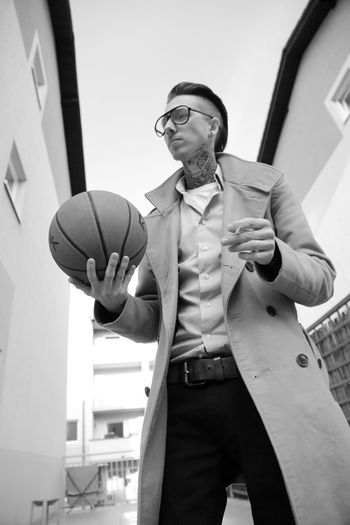 man with ball Architecture Basketball Businessman Day Eyeglasses  Front View Indoors  Low Angle View Minimalism One Person People Real People Smoking Standing Three Quarter Length Well-dressed Wristwatch Young Adult First Eyeem Photo