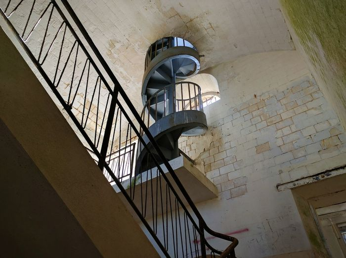 Low angle view of spiral steps and staircases in castle at port-des-barques