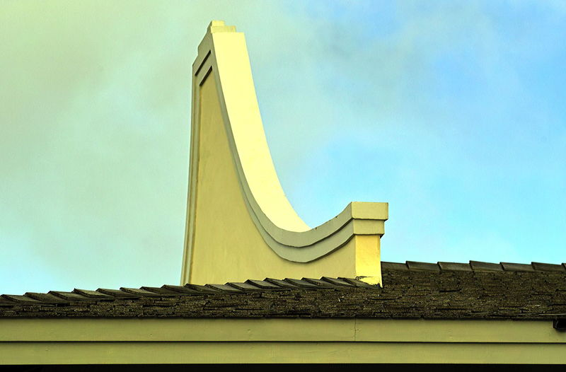 Rooftop details of a traditional plantation house in Curaçao Architectural Detail Architectural Feature Architecture Building Exterior Built Structure Curacao Curacao_island Day Gable Gable End Historic Land House Landhuis Low Angle View No People Outdoors Roof Detail Rooftop Sky Yellow