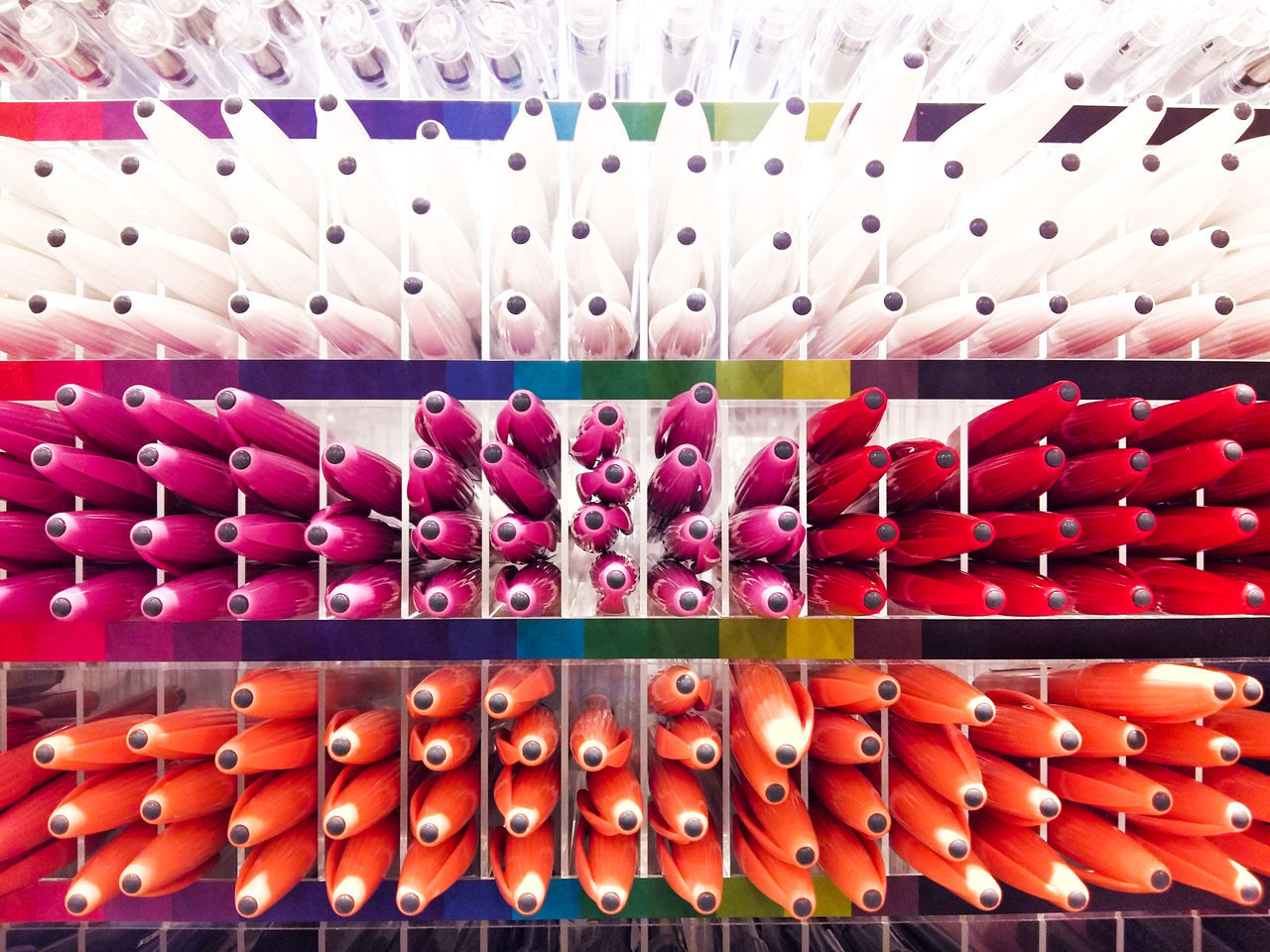 large group of objects, retail, order, in a row, choice, indoors, shelf, variation, abundance, arrangement, no people, multi colored, store, supermarket, close-up, day